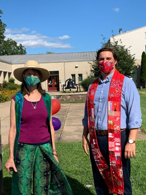 Pastors wearing masks outdoors.